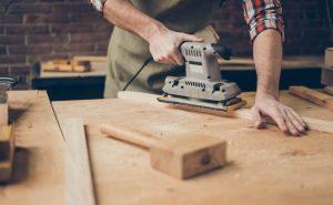 What are the benefits of using orbital sander for sanding?